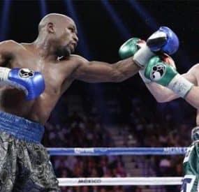Floyd Mayweather Tops Canelo Alvarez In Title Fight