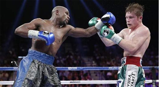 Floyd Mayweather Tops Canelo Alvarez In Title Fight