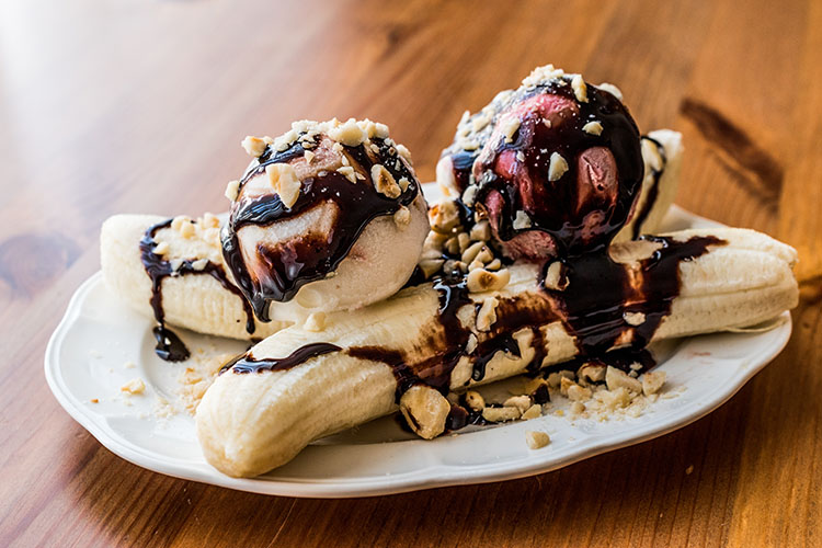 Banana Split With Ice Cream, Chocolate Sauce And Hazelnuts..