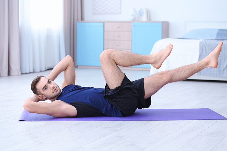man doing bicycle exercise