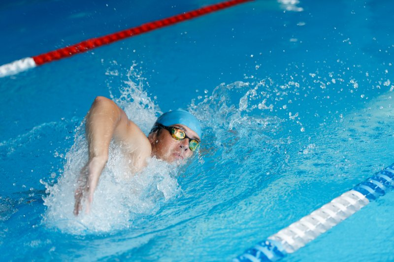 athletic man swimming