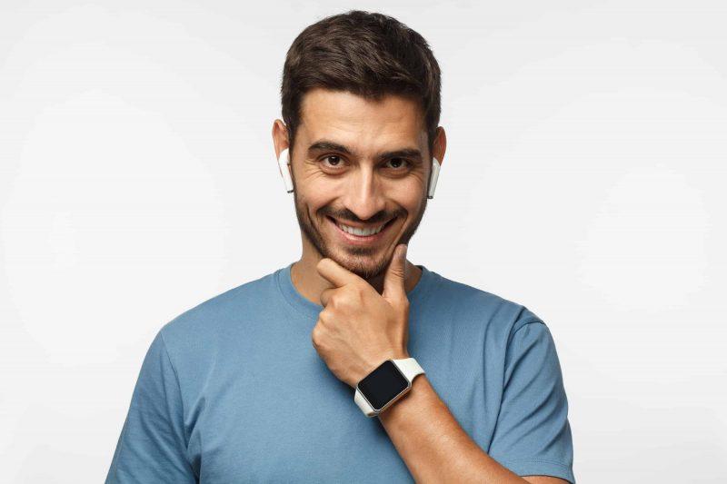 Young man wearing digital watch