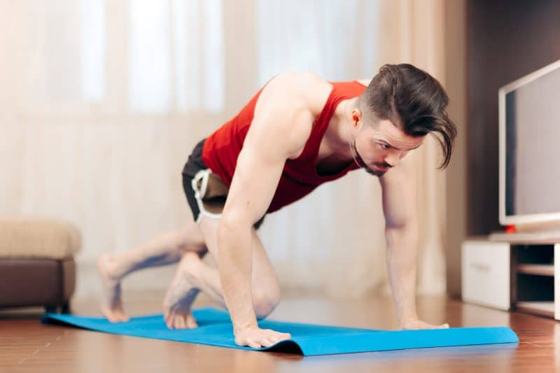 man doing mountain climbers