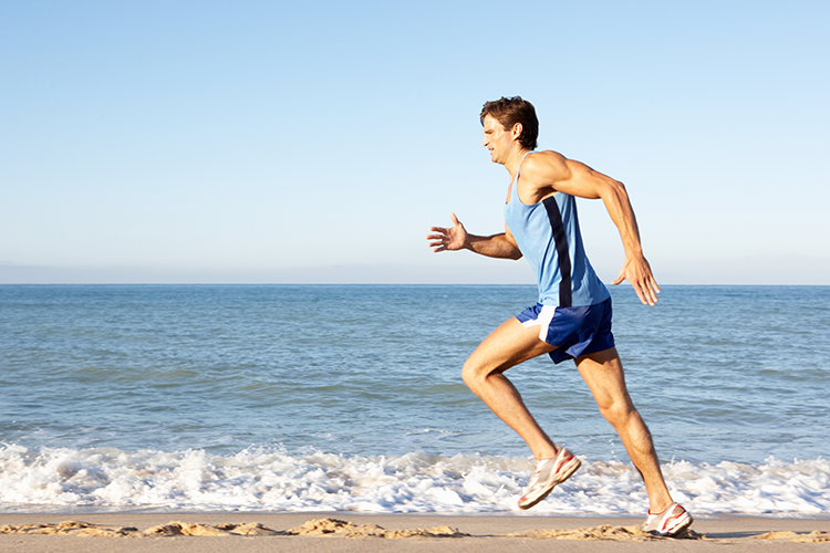 man running near a beach
