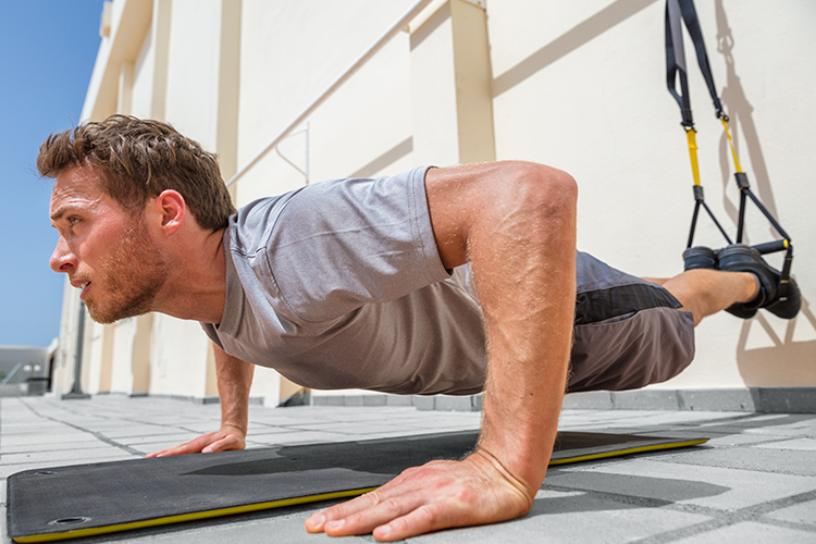 man doing suspended pushup