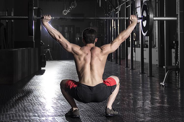 man doing back squats