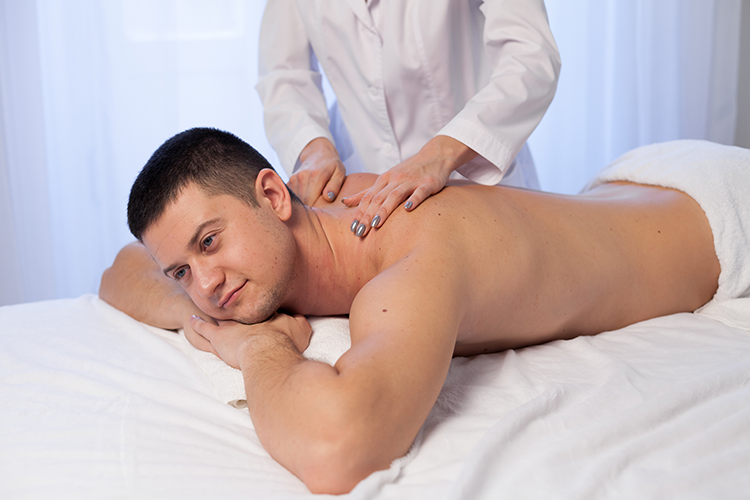 man taking therapeutic massage