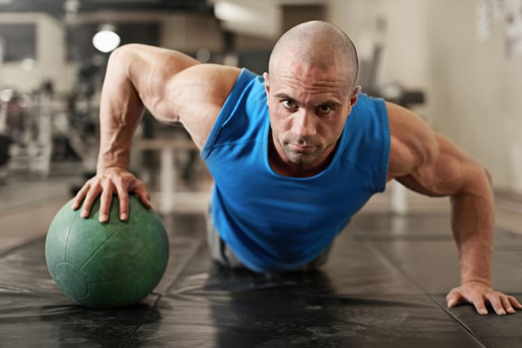 Best 5 Days Workout Split for Building Muscle - med ball pushups